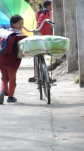 Student bringing her new blanket home on her bicycle